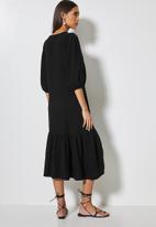 VELVET - Textured button through dropped waist midi - black