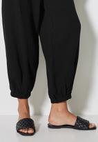 VELVET - Pull on textured balloon pant - black