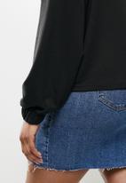 Blake - 3/4 zip cropped printed sweater - black