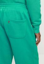 Levi's® - Levis seasonal sweatpant - green & yellow