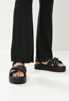 Blake - Flare leg trouser with flossing detail - black