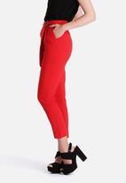 Lavish Alice - Lipstick Red Crossover D-Ring Peg Leg Trousers