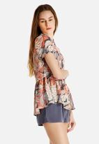 Dahlia - Abstract Print Peplum Blouse
