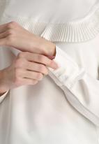 Dahlia - Pleated Bib Detail Blouse