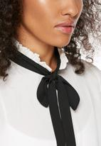Influence. - Ruffled neck pussy bow shirt