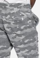 Jack & Jones - Camo tight joggers