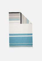 Sixth Floor - Colourful teal stripe rug