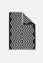 Sixth Floor - Black diamond rug