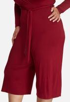Missguided - Plus size jersey wrap plunge jumpsuit