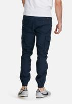 PRODUKT - Washed cuff pants