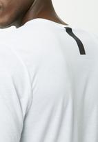 Nike - Futura Tee