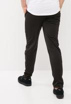 PUMA - Tricot Slim Leg Pants - Black