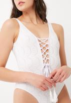 Missguided - Crochet style lace up front swimsuit