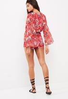 Missguided - Floral print flare sleeve playsuit