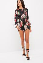 Missguided - Floral print open frill back playsuit