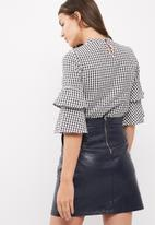 ONLY - Pepita flared gingham blouse