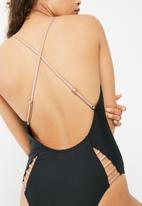 South Beach  - Low back swimsuit with rose gold bar panels