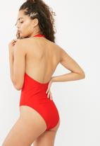 South Beach  - Halterneck zip front swimsuit