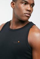 Superdry. - Orange label vintage EMB vest