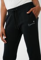 Converse - Essentials leopard star print joggers