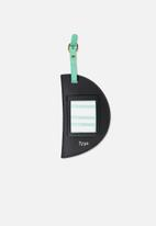 Typo - Shape shifter luggage tag