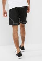 Asics - Premium knit shorts