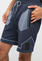 Asics - Premium knit shorts