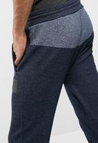 Asics - Premium knit pants