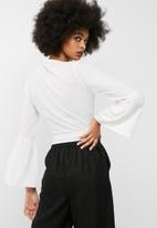 dailyfriday - Bell sleeve wrap top