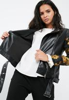 Missguided - Faux leather biker jacket with floral jacquard sleeves