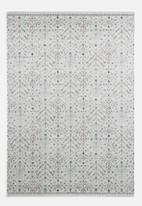 Sixth Floor - Antique rug - cream & light brown