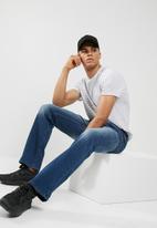 GUESS - Slim bootleg jean