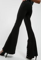 Missguided - Eyelet detail kick flare trousers