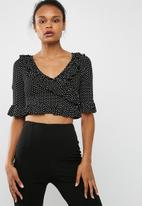 Missguided - Black wrap polka dot frill crop top