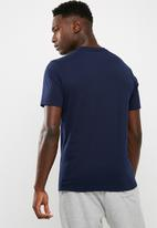 New Balance  - Core track club tee