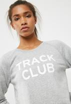 New Balance  - Essentials track club crew sweat