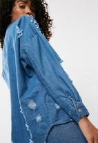 Missguided - Distressed denim shirt with pearl detail