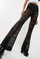 Missguided - Carli Bybel x Missguided lace wide leg trousers