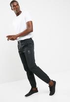 ASICS - Track pants