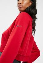Nike - Versa GRX slogan top