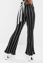 Missguided - Striped plisse flared leg trousers