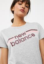 New Balance  - Stripe logo tee