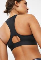 New Balance  - Medium impact sports bra - black