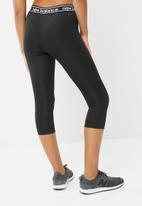 New Balance  - Accelerate capri tights