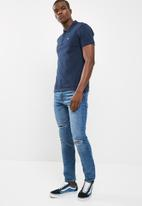 Levi's® -  Housemark Polo - Dress Blues
