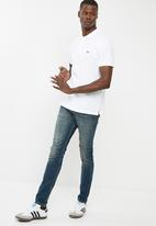 Levi's® - House Mark Polo - Bright White