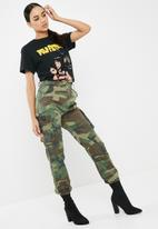 Missguided - Pulp fiction graphic distressed oversized t-shirt