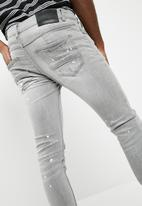 Sergeant Pepper - Rip and repair feather slim fit jeans