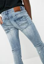 Sergeant Pepper - Paint splattered feather slim fit jeans