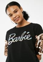 38274bb7510 Barbie glitter logo sequin sleeve T-shirt dress - Black Missguided ...
